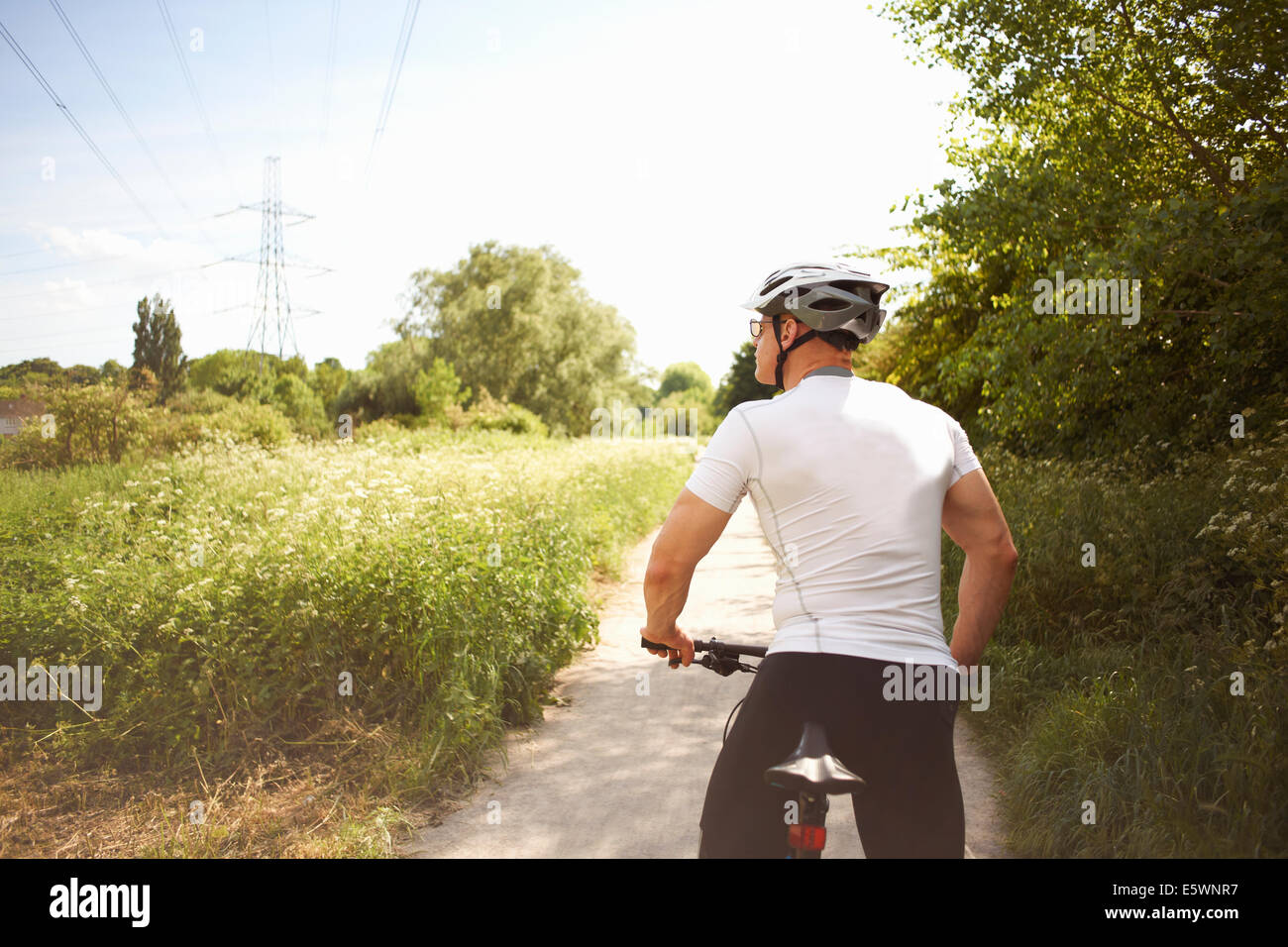 Cyclist stopping for break - Stock Image