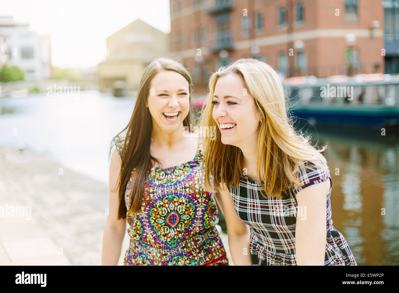 Female friends laughing - Stock Image