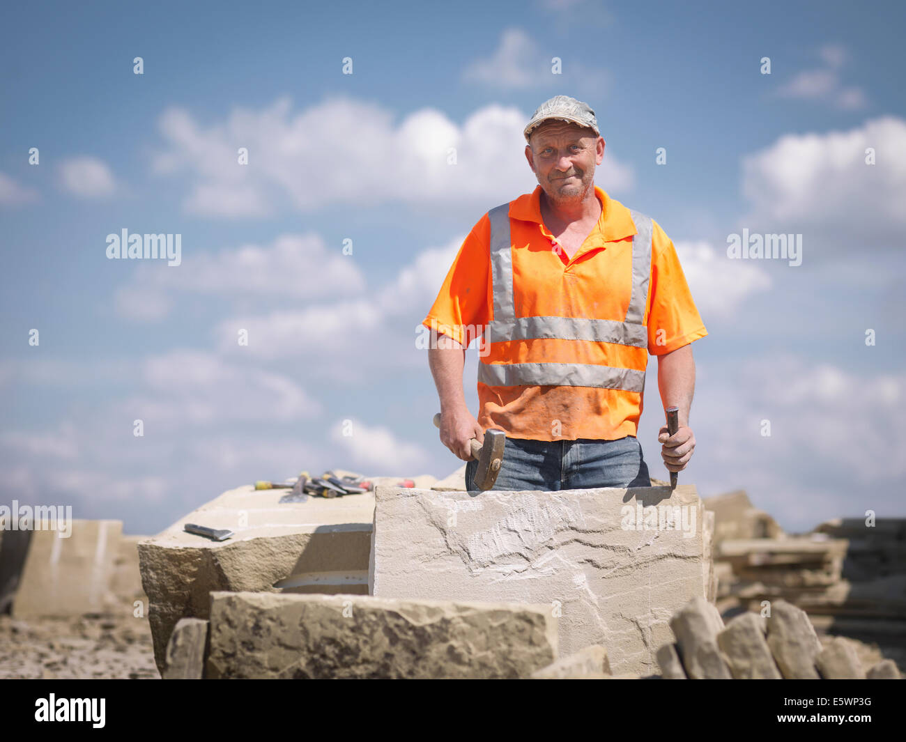 Quarry worker with sandstone in Yorkshire stone quarry, portrait - Stock Image