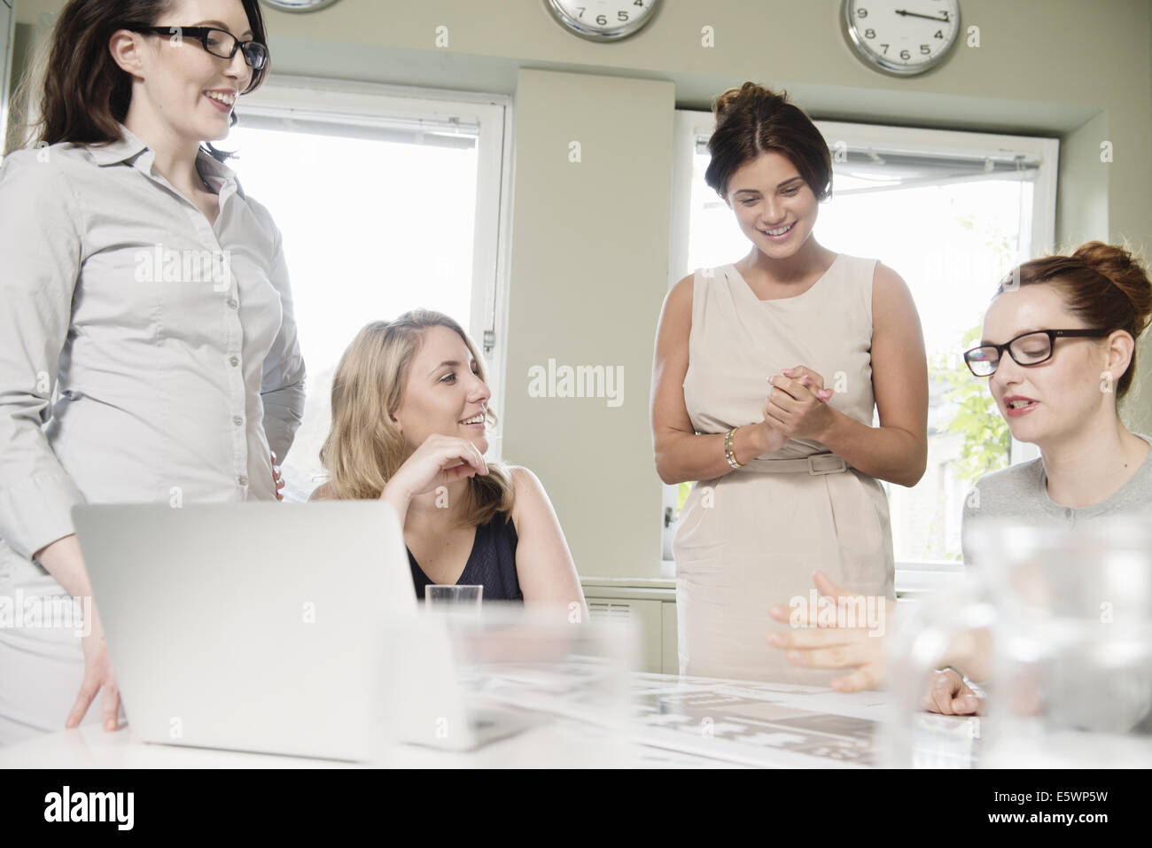 Four businesswomen at presentation meeting in conference room Stock Photo