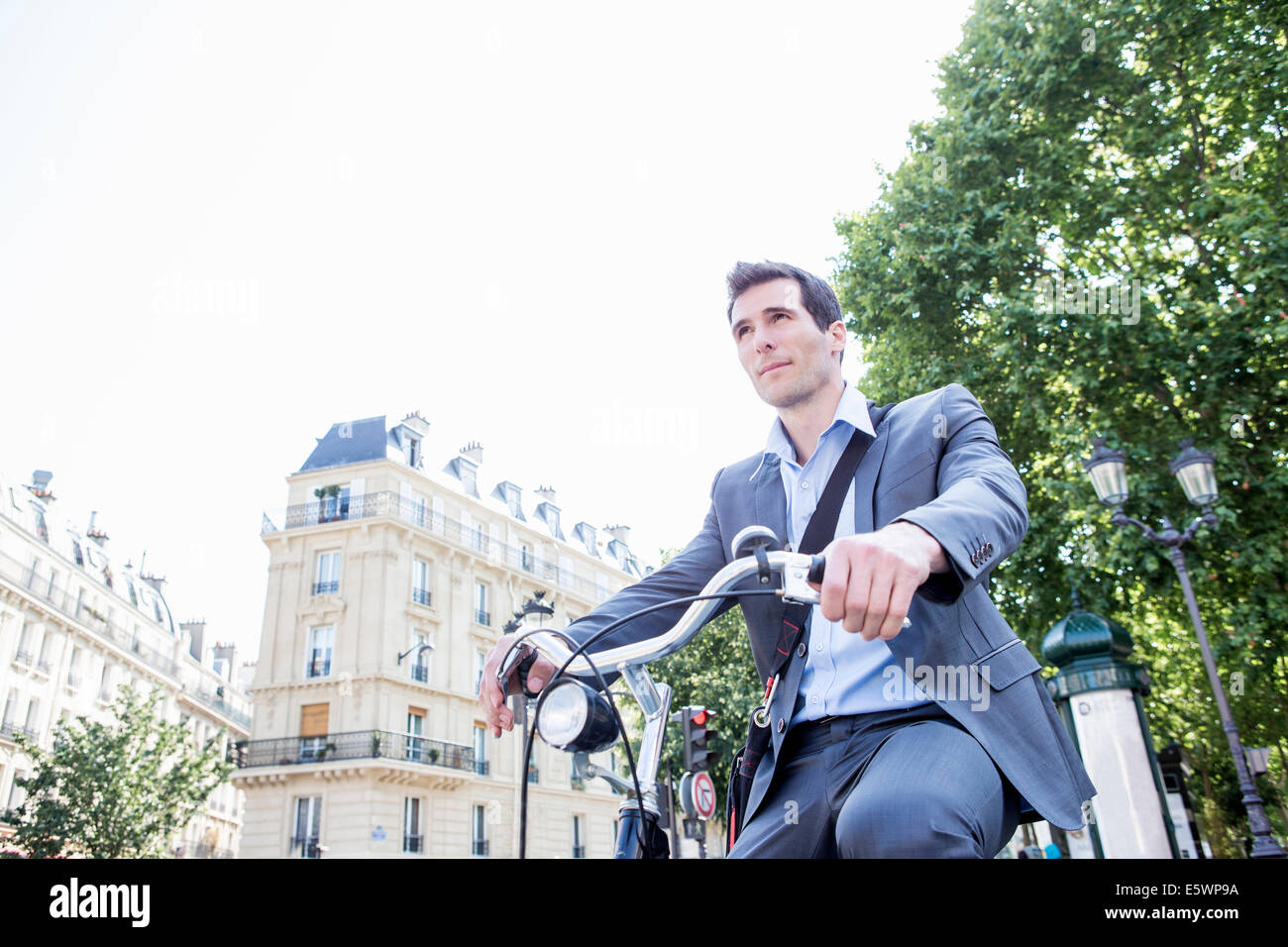 Mid adult businessman commuting on bicycle, Paris, France - Stock Image