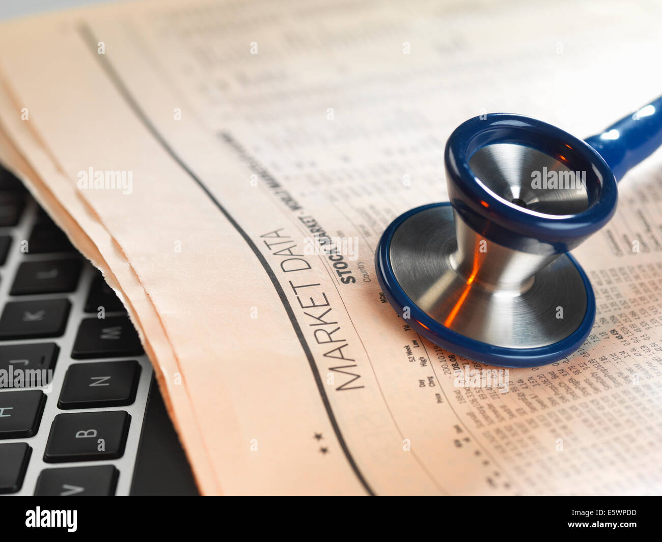 Financial health check: stethoscope on newspaper with financial markets for investing - Stock Image
