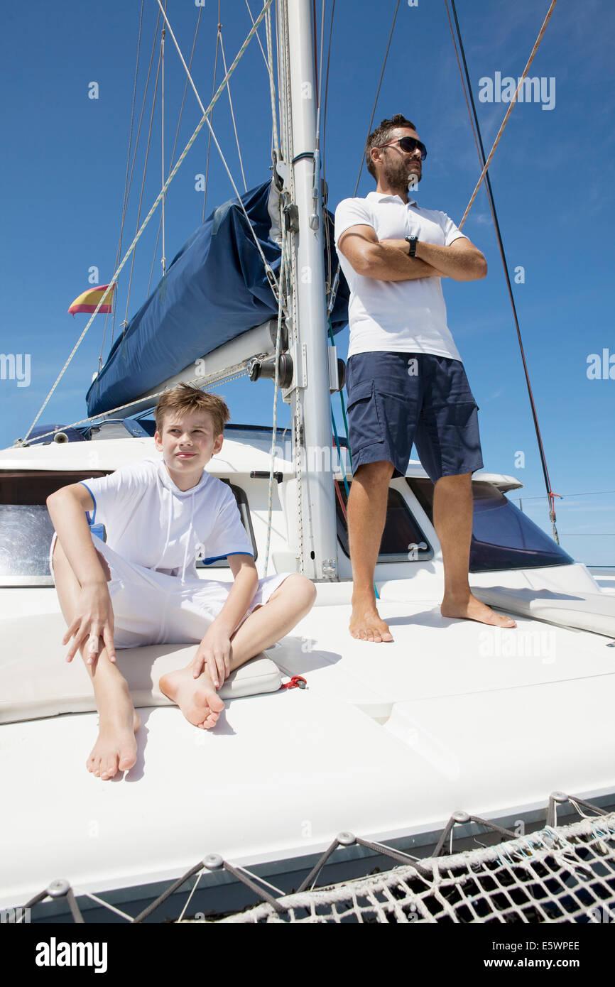 Father and son sailing catamaran off Fuerteventura, Spain - Stock Image