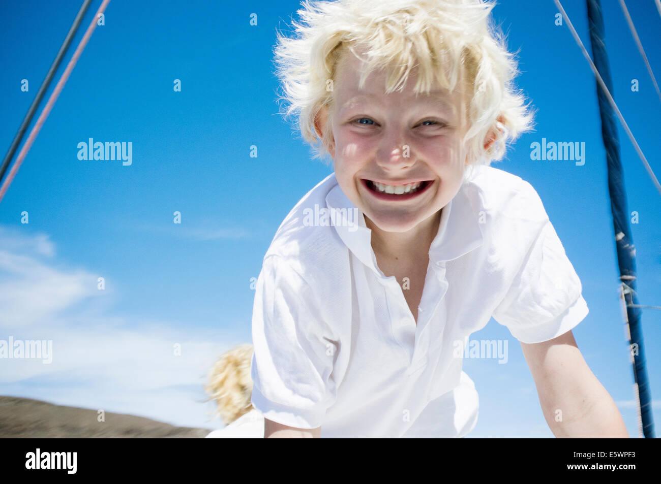 Portrait of enthusiastic boy on catamaran near Fuerteventura, Spain - Stock Image