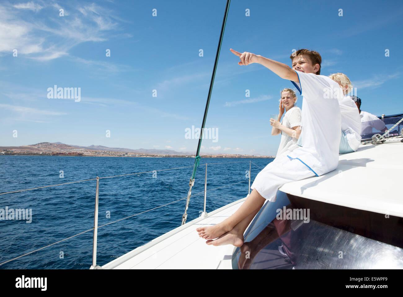 Parents and three sons sailing on catamaran near Fuerteventura, Spain - Stock Image