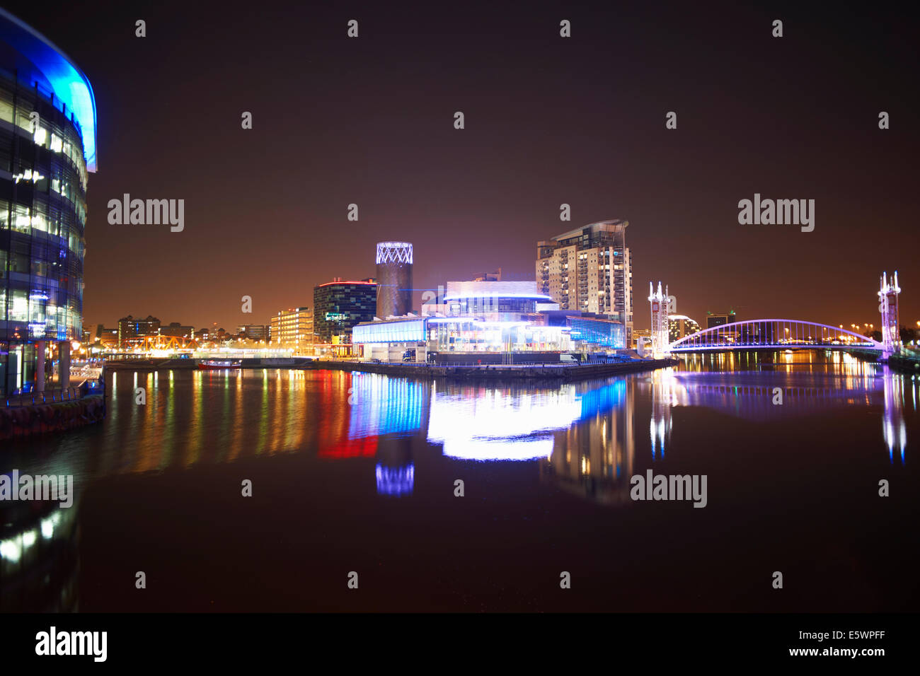 Media City and canal at night, Manchester, UK - Stock Image