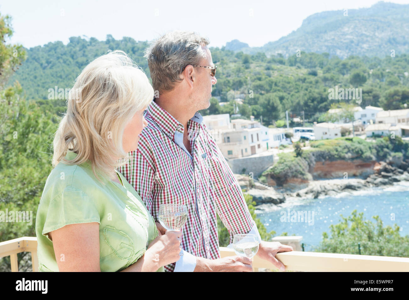 Couple celebrating on holiday, Mallorca, Spain - Stock Image