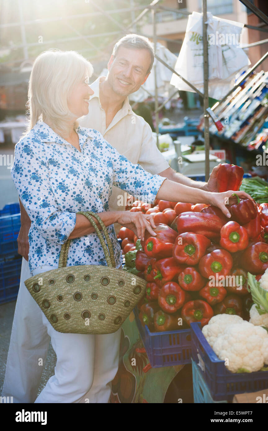 Couple choosing capsicum at market, Mallorca, Spain - Stock Image