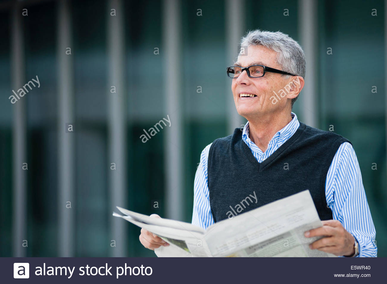 Senior adult businessman making notes on plan - Stock Image