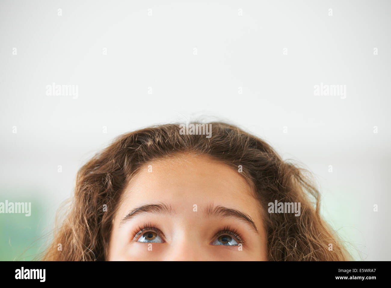 Portrait of young girl, focus on eyes - Stock Image