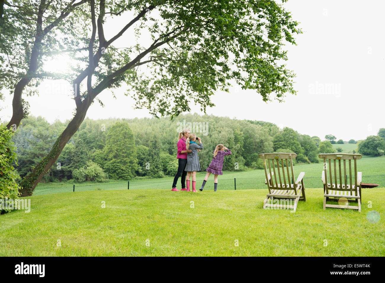 Mother and daughters in field - Stock Image