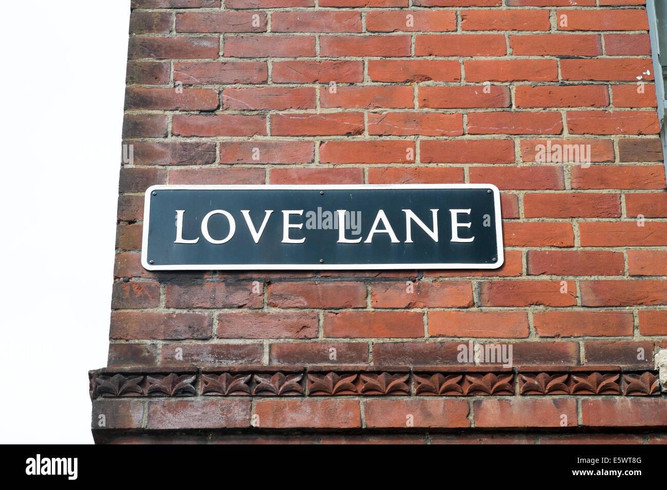 Love Lane street name sign on side of red brick building UK - Stock Image