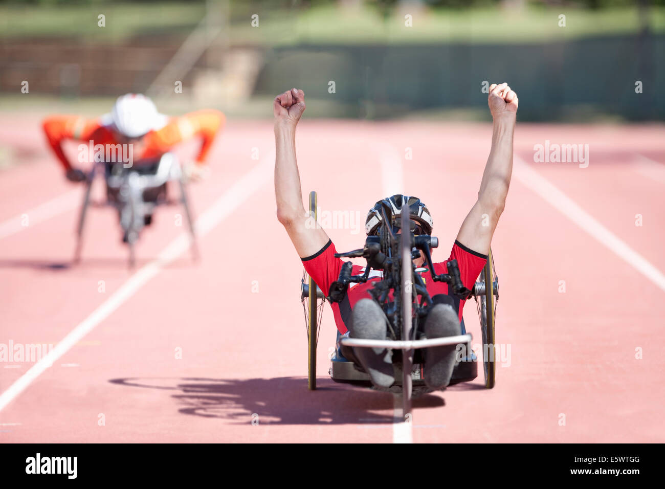 Athlete at finishing line in para-athletic competition - Stock Image