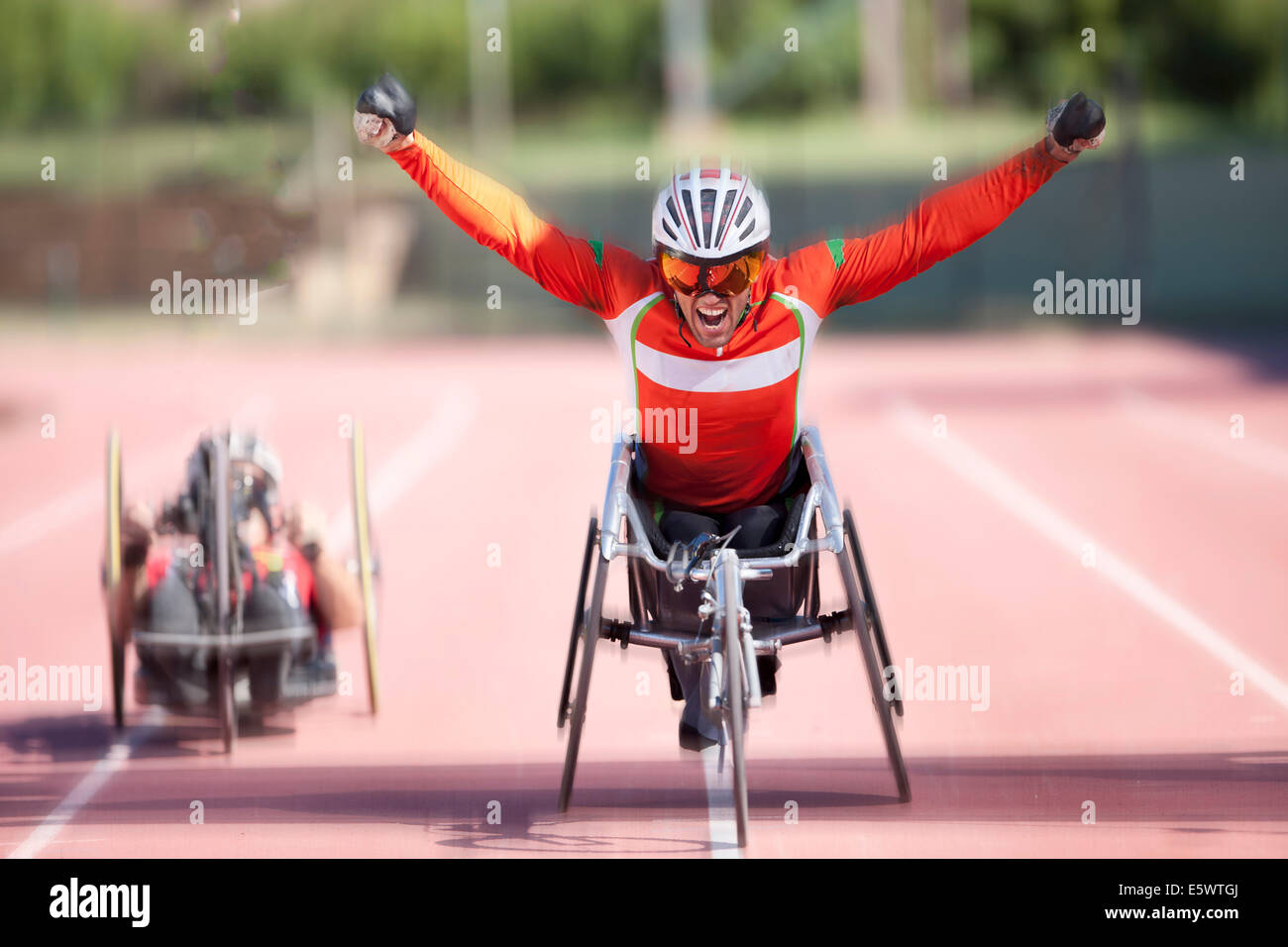 Athlete at finishing line in para-athletic competition Stock Photo