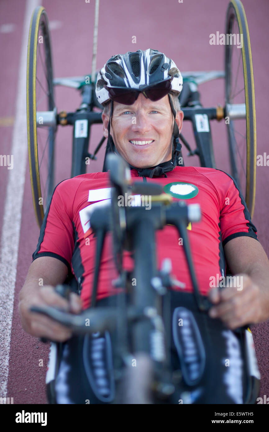 Close up of cyclist in para-athletic training - Stock Image