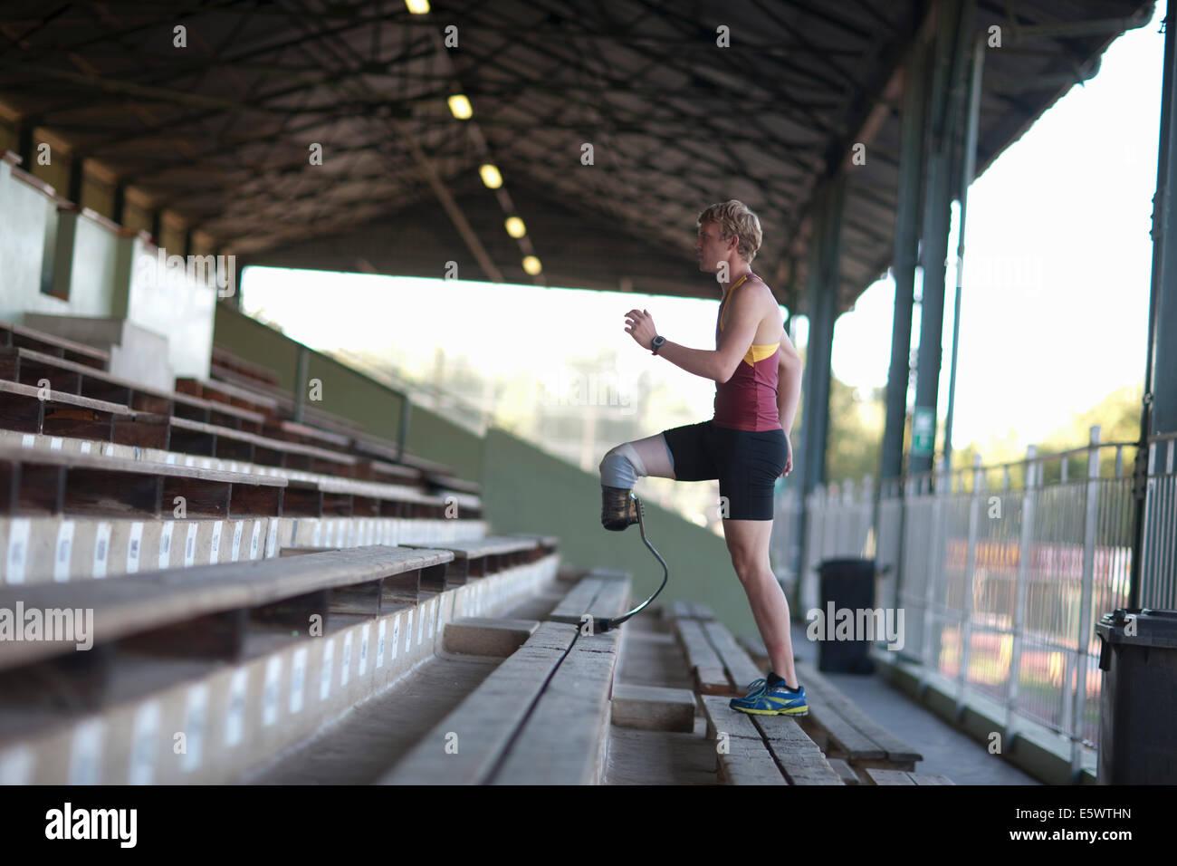 Sprinter walking with prosthetic leg on - Stock Image