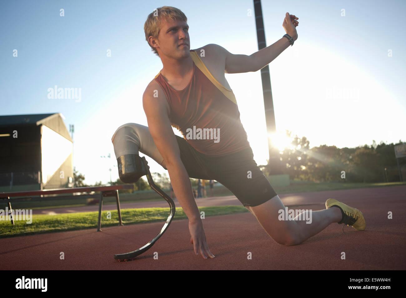 Sprinter stretching - Stock Image