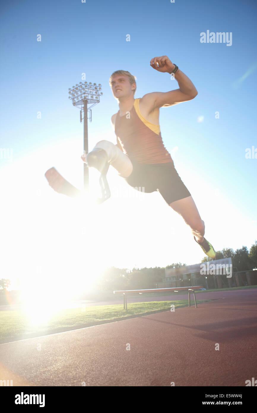 Sprinter mid-jump - Stock Image