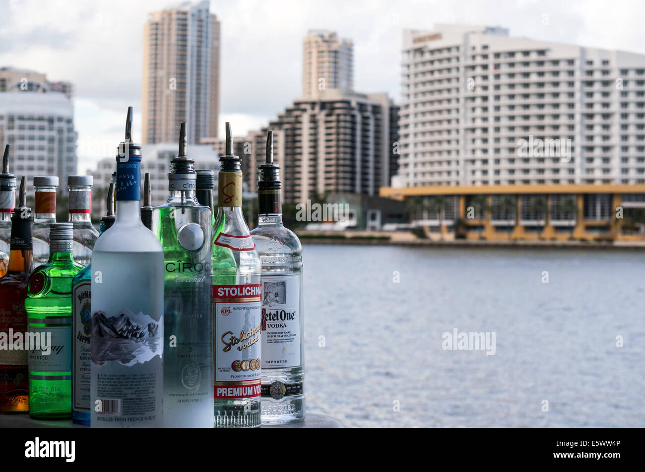 Liquor bottles sit on the patio bar of Crazy About You restaurant on Biscayne Bay in Brickell area of Miami, Florida. Stock Photo