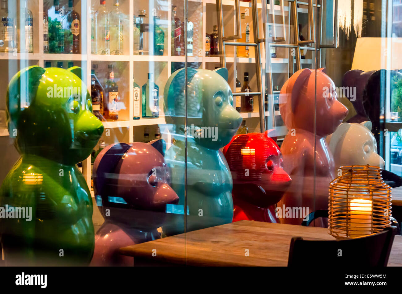 Colorful ceramic bears guard the wine and liquor cellar of the Brickell Miami restaurant, Crazy About You on Biscayne Stock Photo