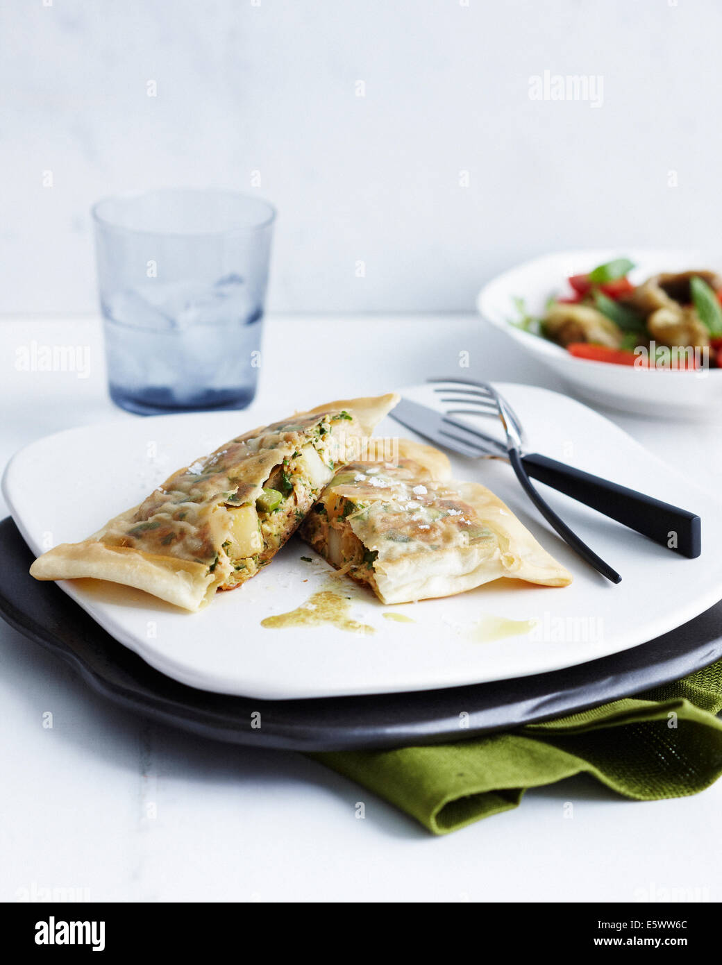 Plate with tuna and egg briks and side dish - Stock Image