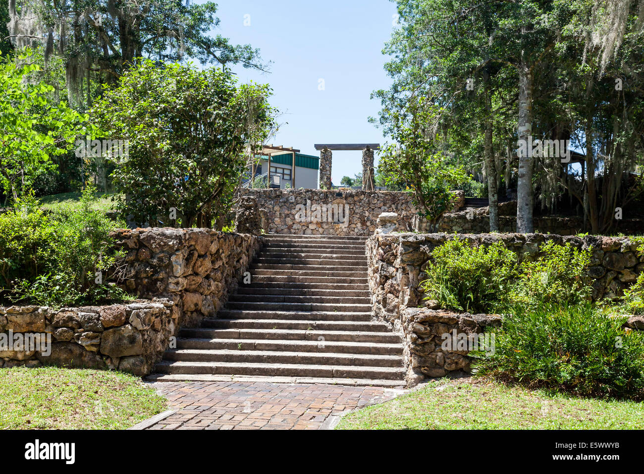 Tiered landscaping with stone retaining walls flank steps ... on Tiered Yard Landscaping id=45646