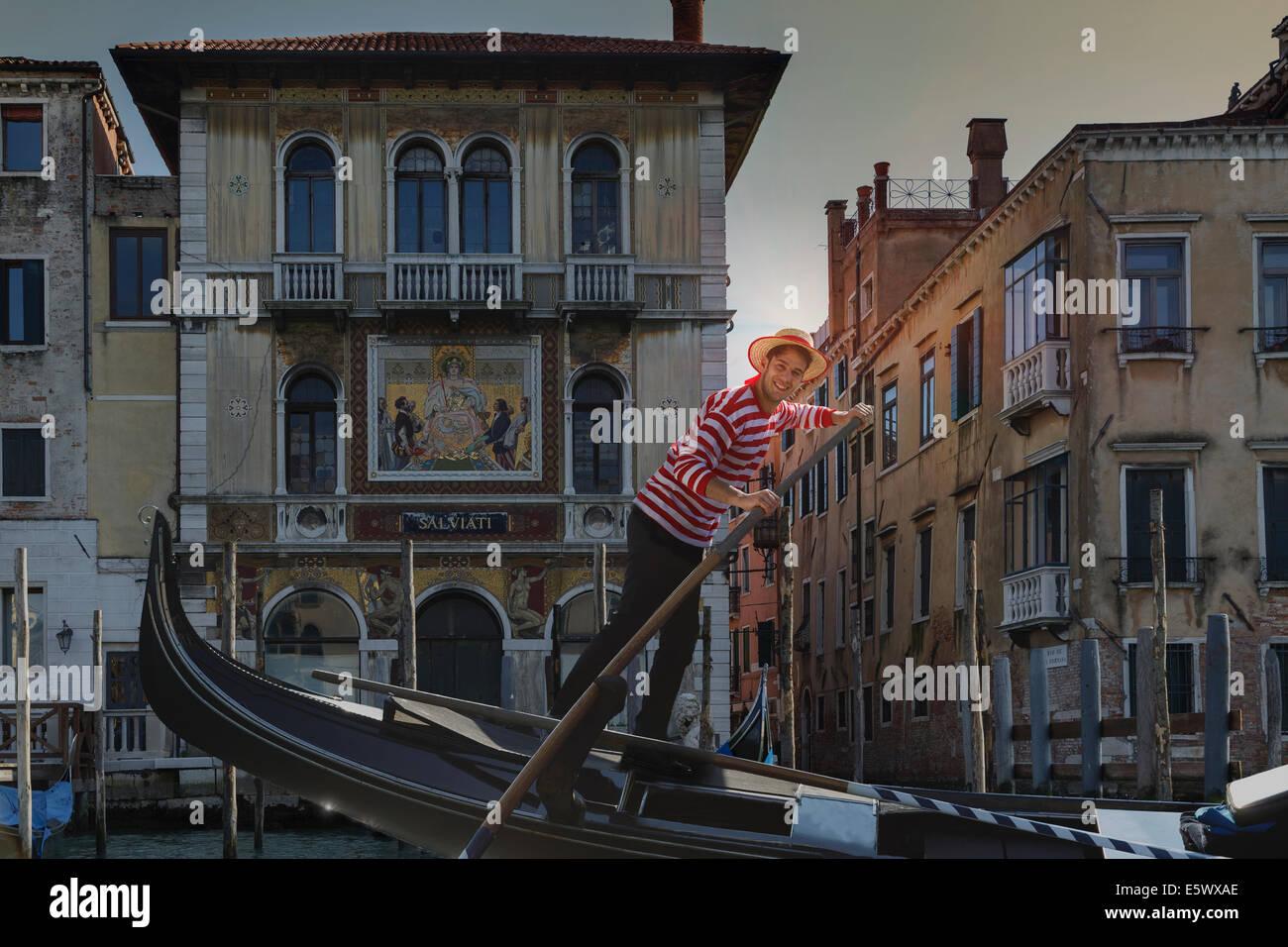 Gondolier on Grand canal, Venice, Veneto, Italy - Stock Image