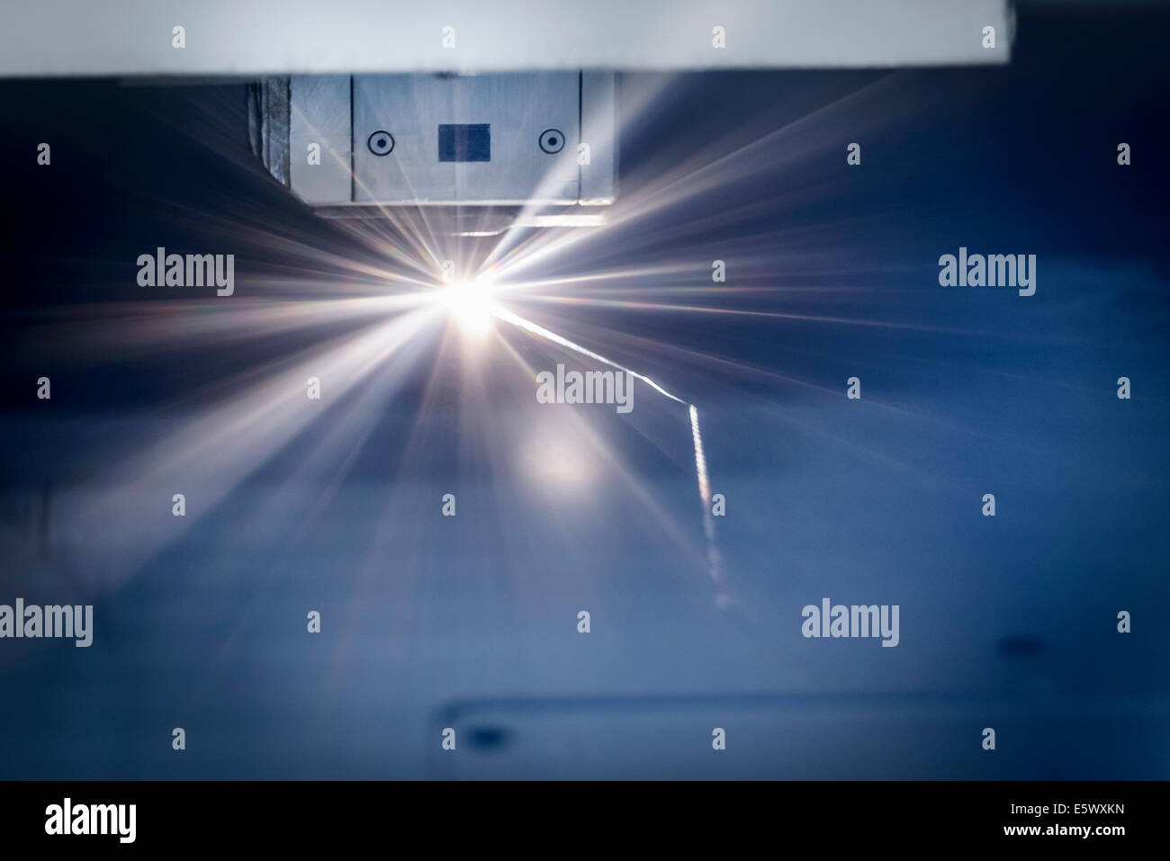 Laser cutter cutting metal in sheet metal factory - Stock Image