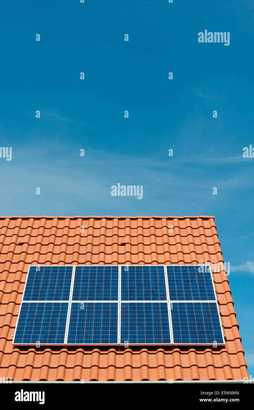 Newly installed solar panels on roof of new home, Netherlands - Stock Image