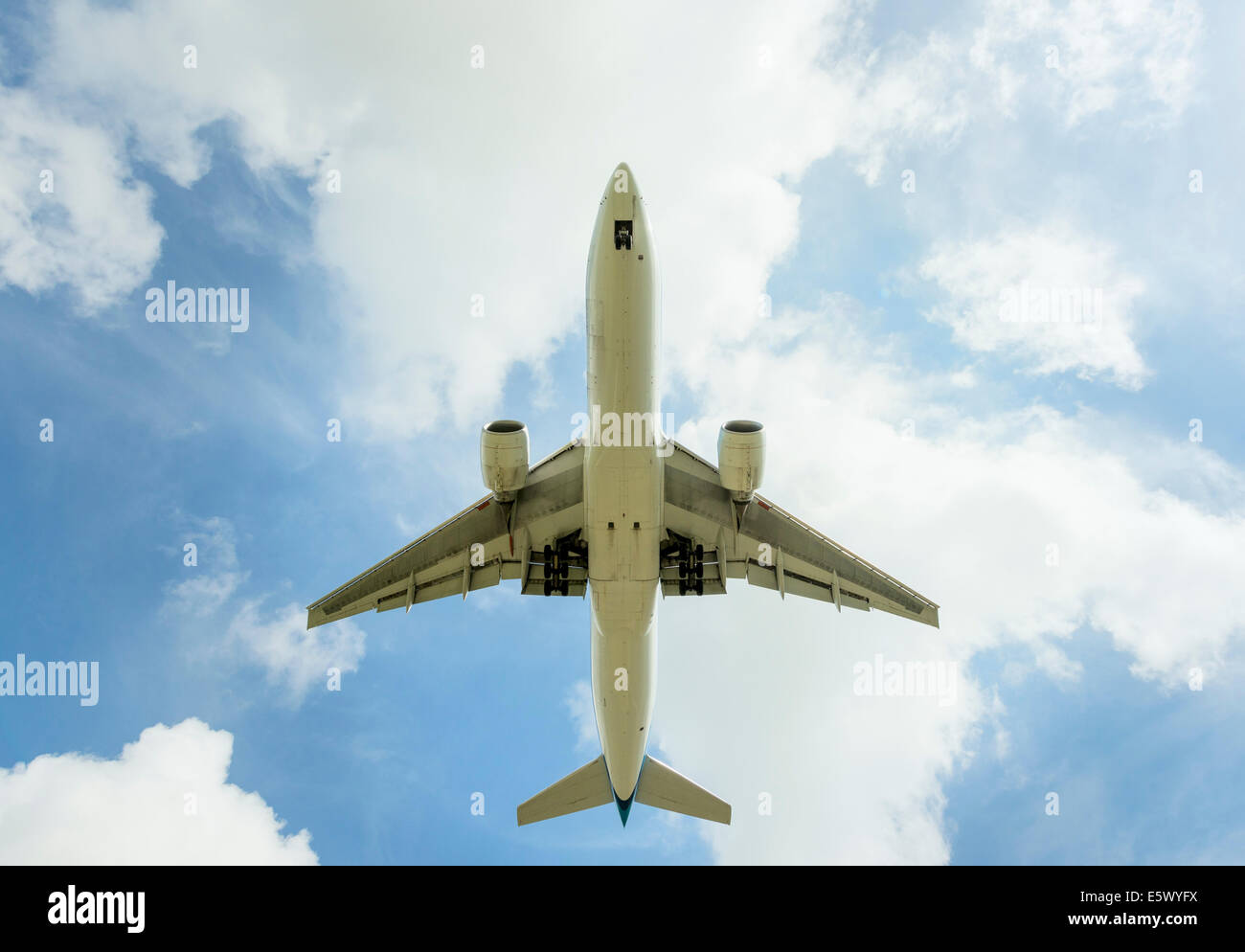 Aeroplane approaching Amsterdam Airport Schiphol, viewed from below - Stock Image