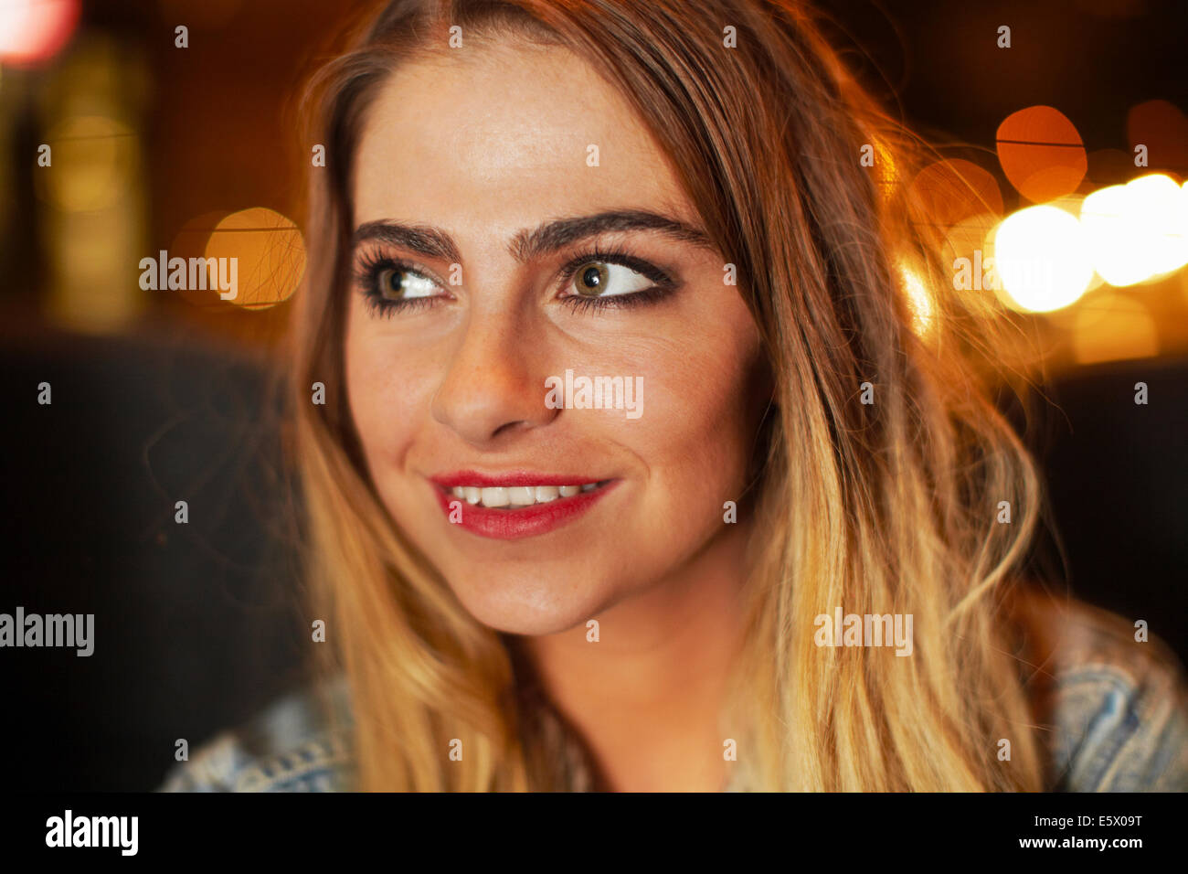 Beautiful young woman going out in city taxi at night - Stock Image