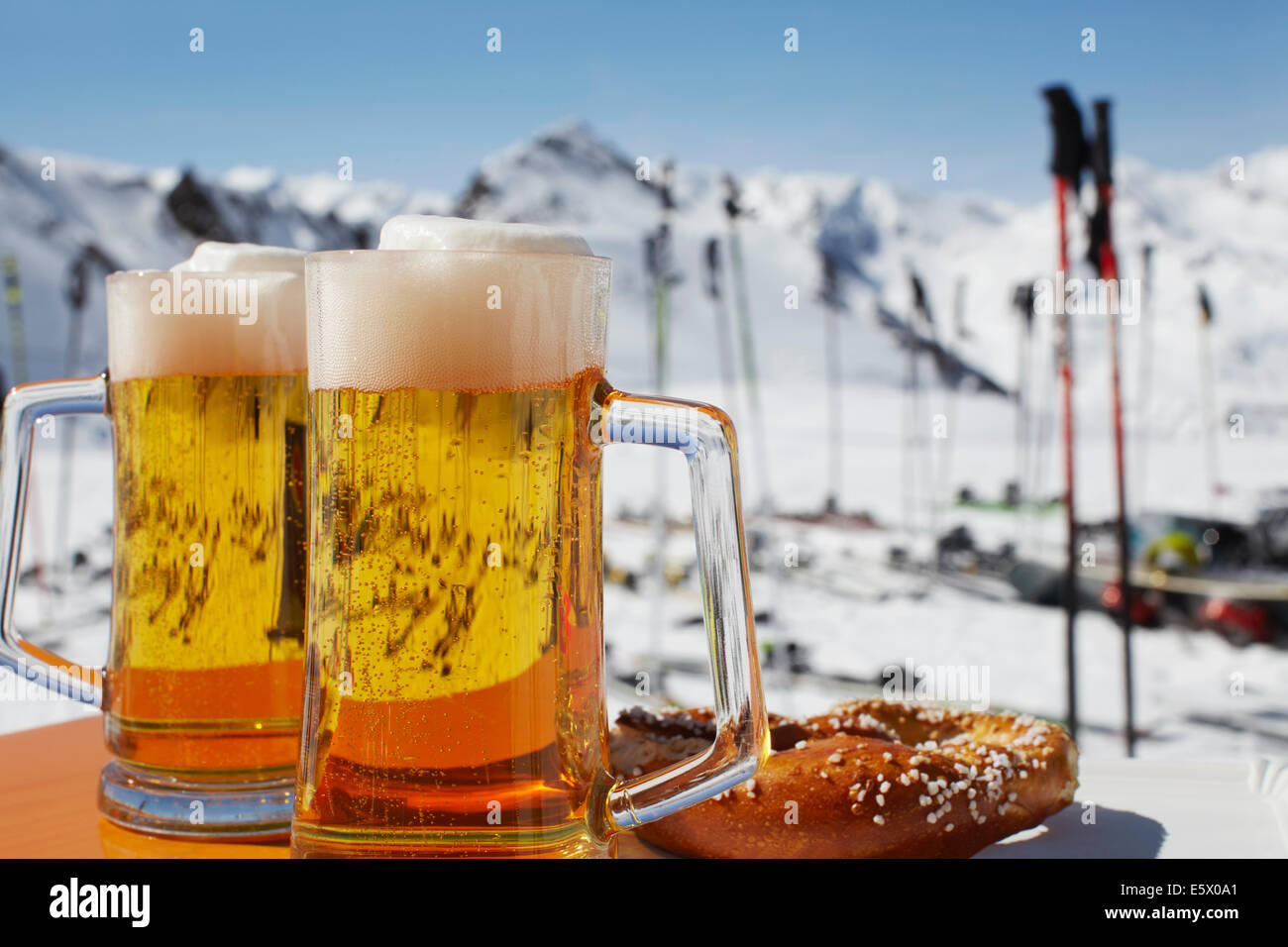 Two glasses of beer on outdoor cafe table, Austria - Stock Image