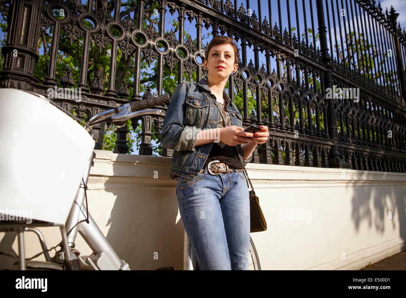 Young adult woman using mobile phone Stock Photo