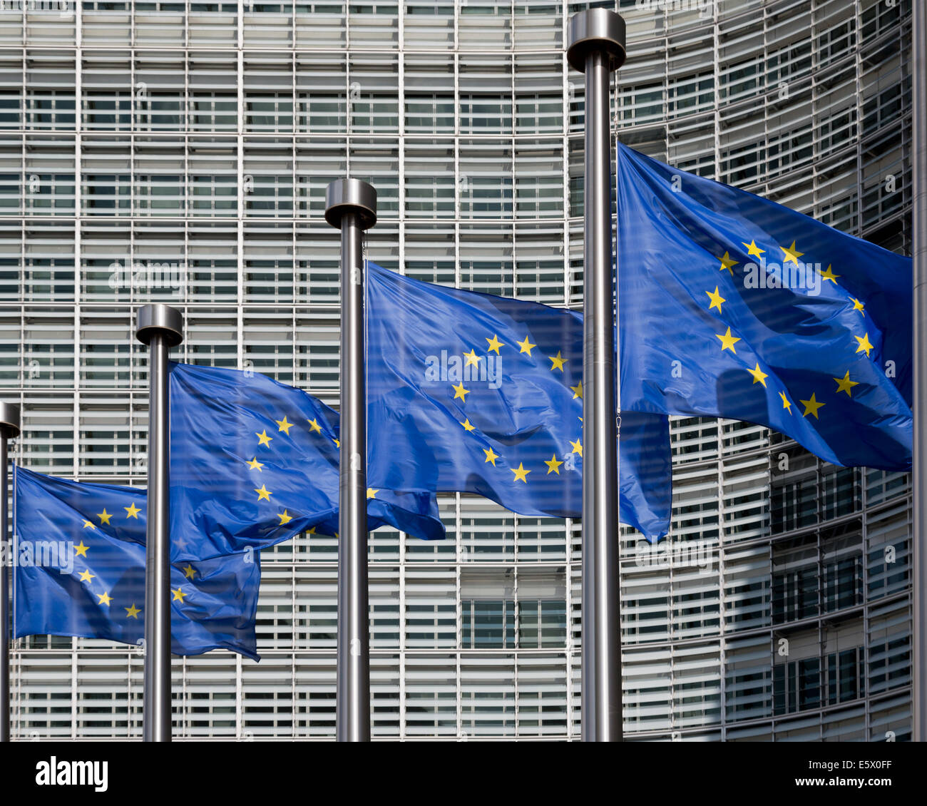 European flags outside the Berlaymont office of European Commission, Brussels, Belgium - Stock Image