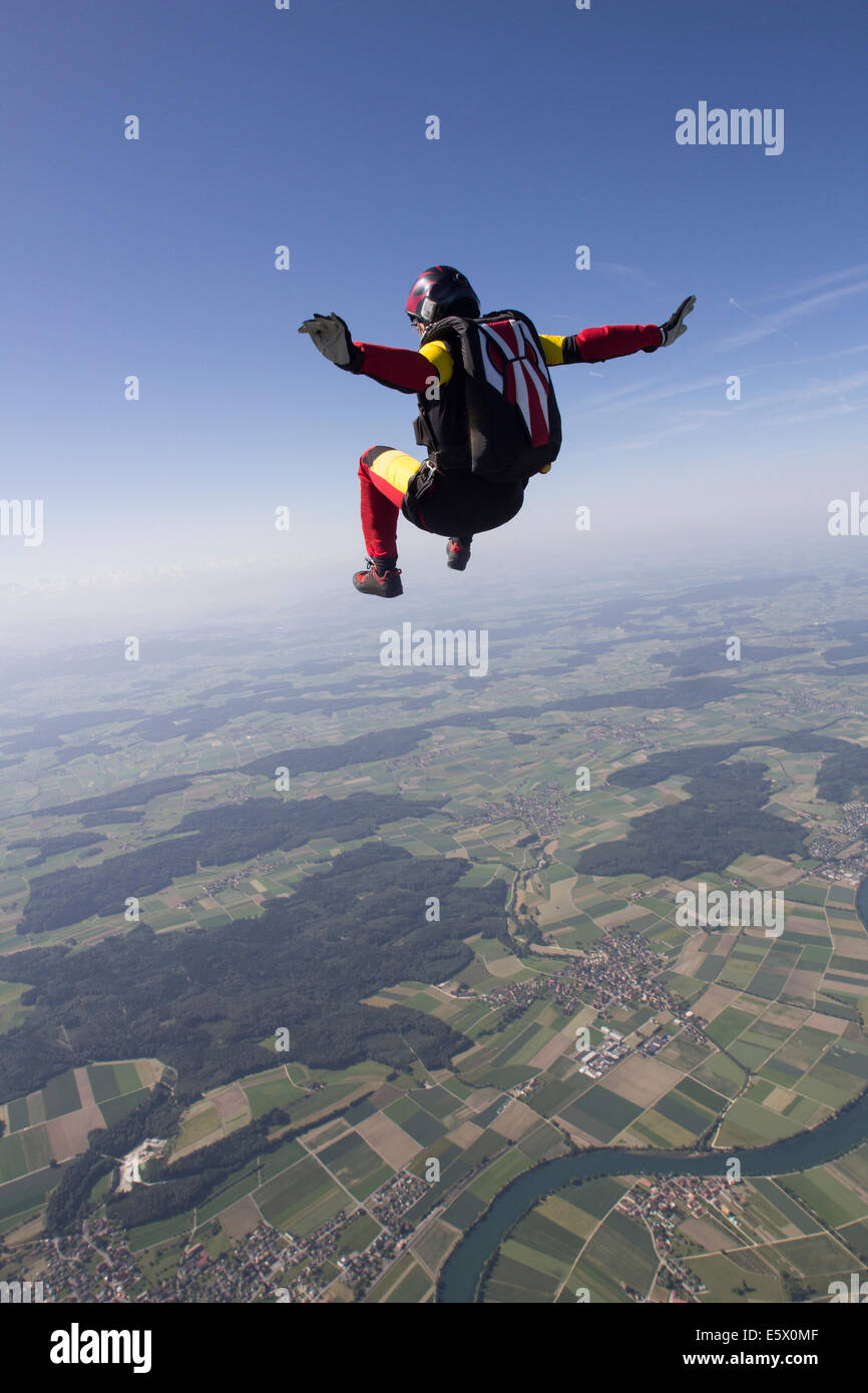 Female skydiver free falling over Grenchen, Berne, Switzerland - Stock Image