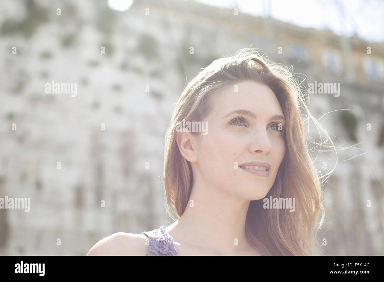 Portrait of a young woman, looking to the future - Stock Image