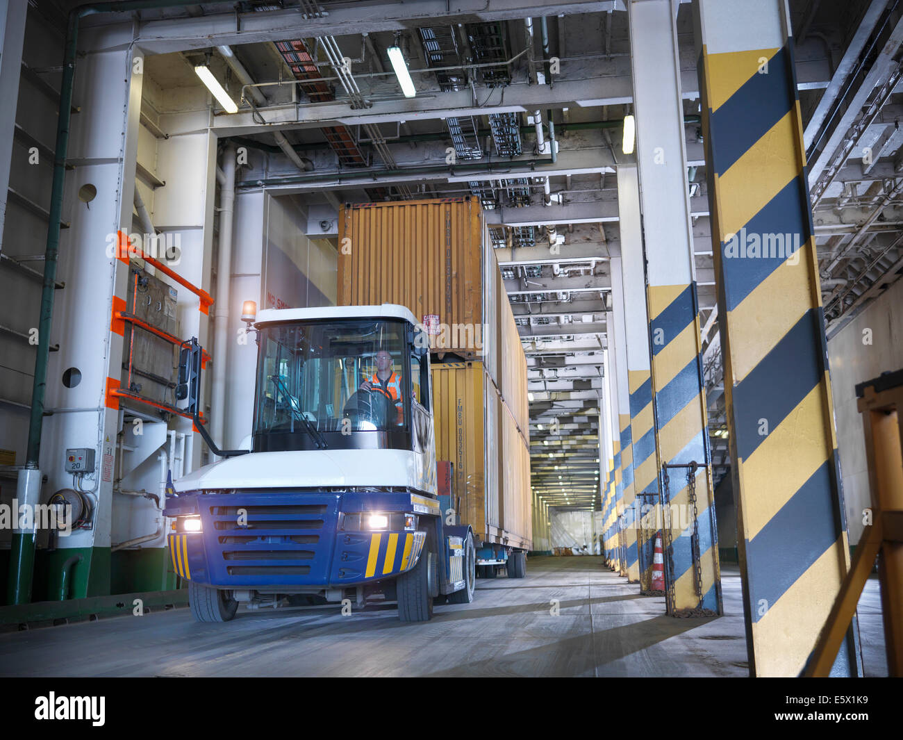 Shipping container loaded into ferry hold - Stock Image