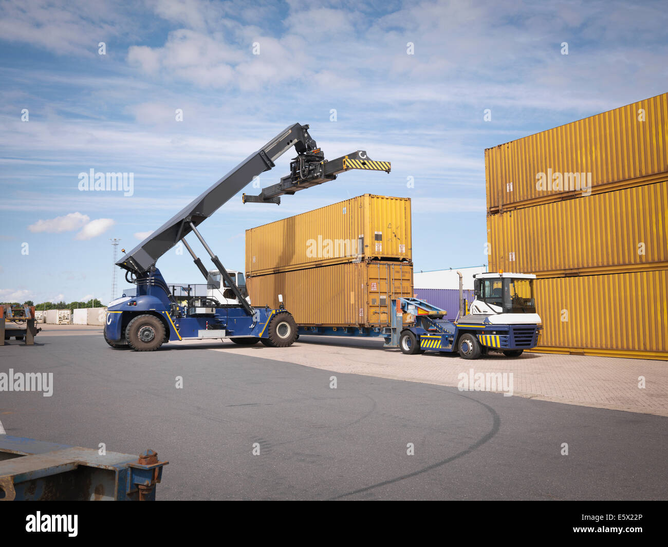Shipping container stacker in port - Stock Image