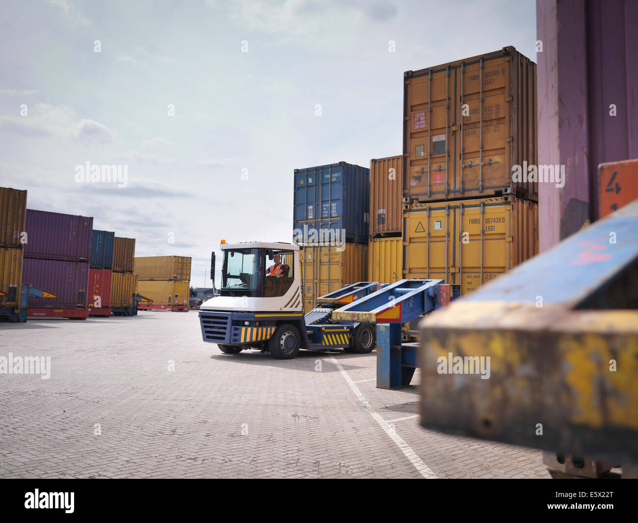 Shipping containers and truck in port Stock Photo