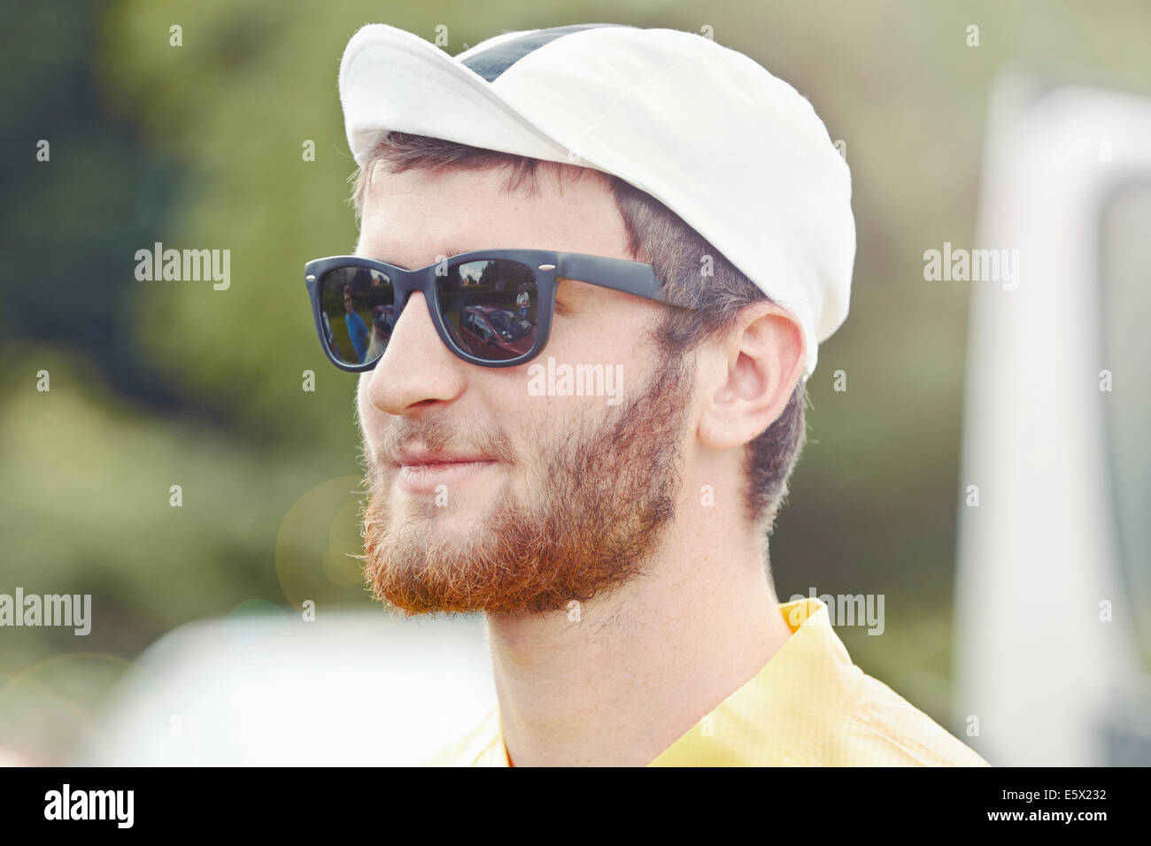 Cyclist wearing biking cap and sunglasses - Stock Image
