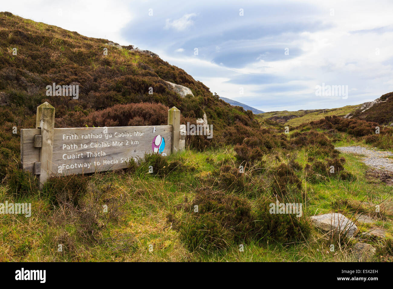 Bilingual Gaelic sign for footpaths to Caolas Mor and Hecla near Loch Sgioport South Uist Outer Hebrides Western - Stock Image