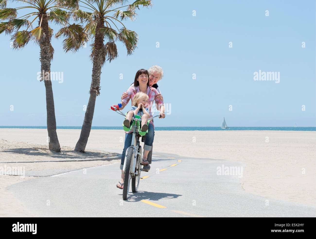 Mother, daughter and grandson on one bicycle, Venice Beach, California, USA - Stock Image