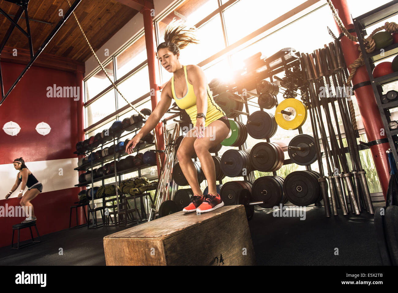 Bodybuilders working out in gym - Stock Image