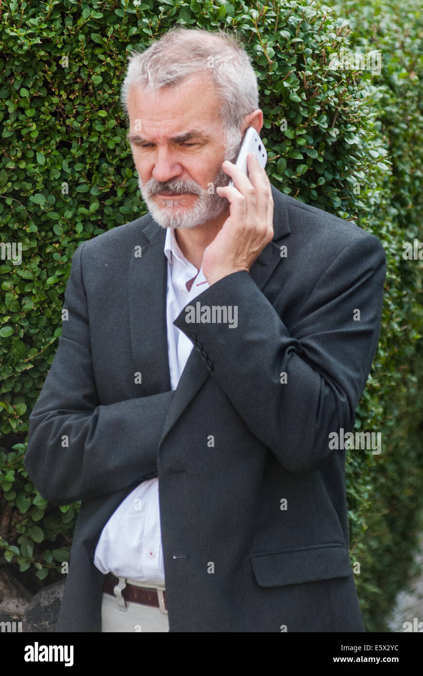 London, UK. 7th August, 2014.  Conservative member of the London Assembly, Andrew Boff, speaks on the phone as the - Stock Image