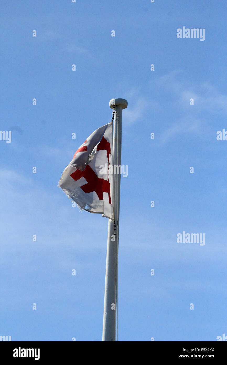 English Heritage Flag flying in the wind - Stock Image