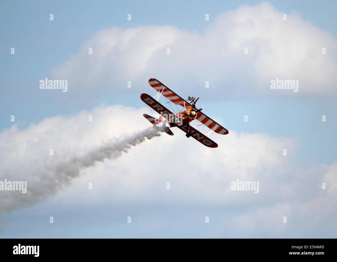 Breitling bi-plane in a aerobatic display - Stock Image