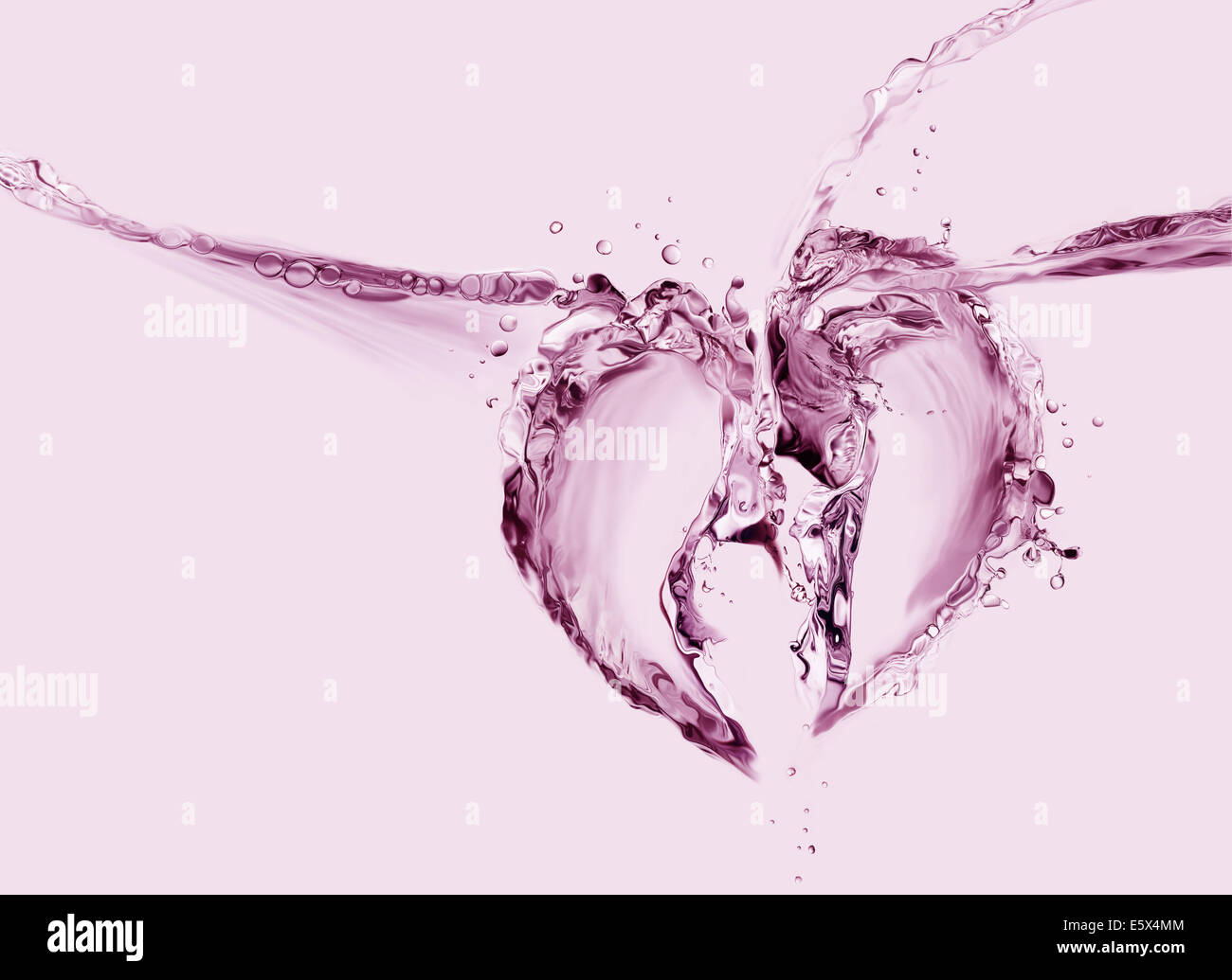 A broken heart made of red liquid splashing in two pieces. - Stock Image