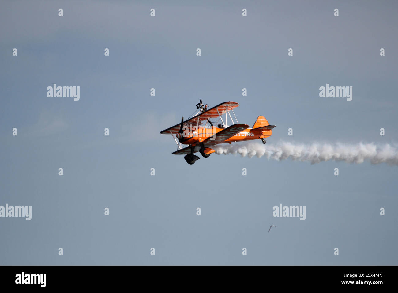 Breitling biplane flying at Bournemouth Air Show - Stock Image