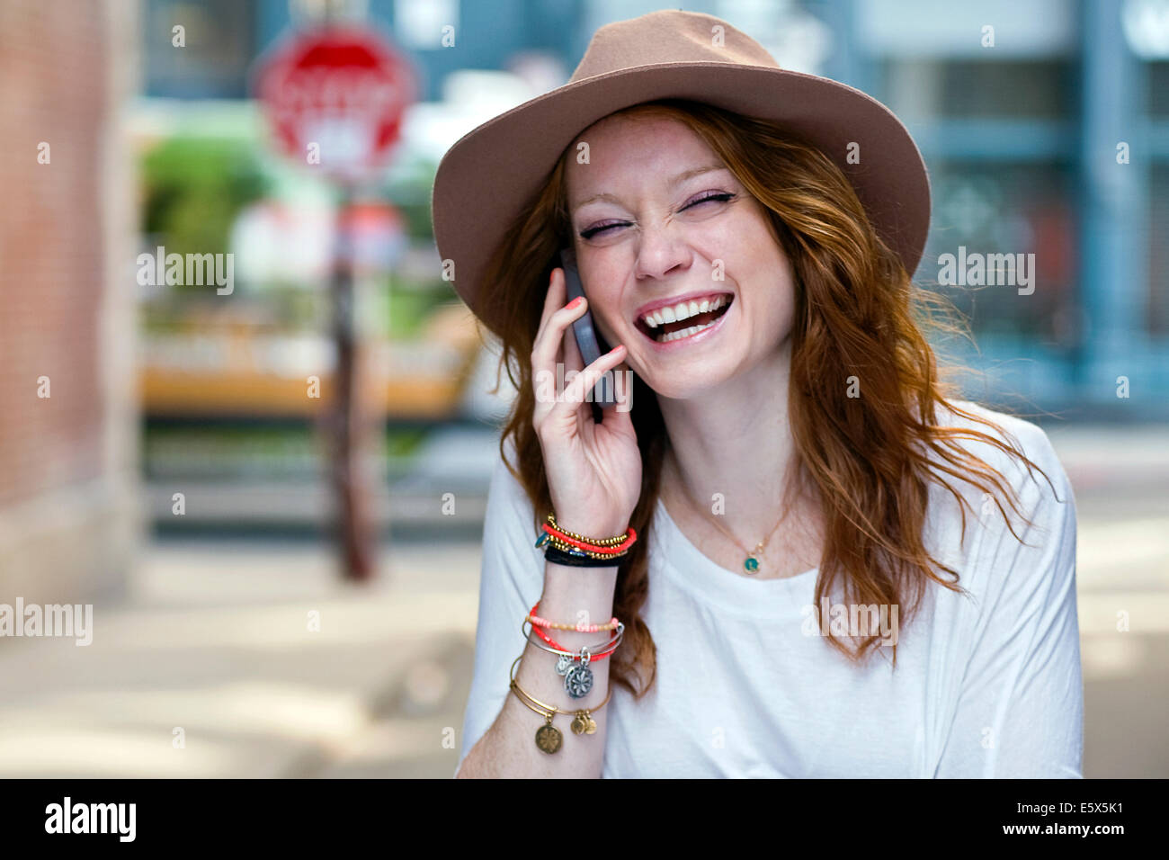 Portrait of young woman using mobile phone Stock Photo