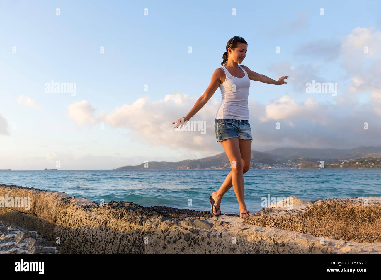 Mid adult woman walking along pier, Spice Island beach resort, Grenada, Caribbean Stock Photo
